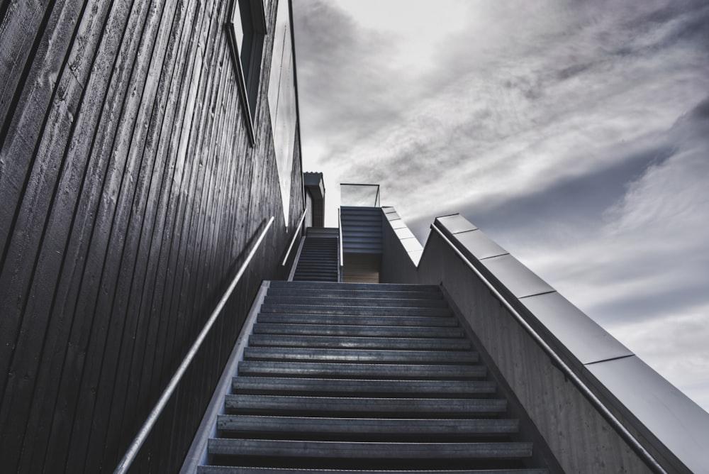 ladder near building under white clouds