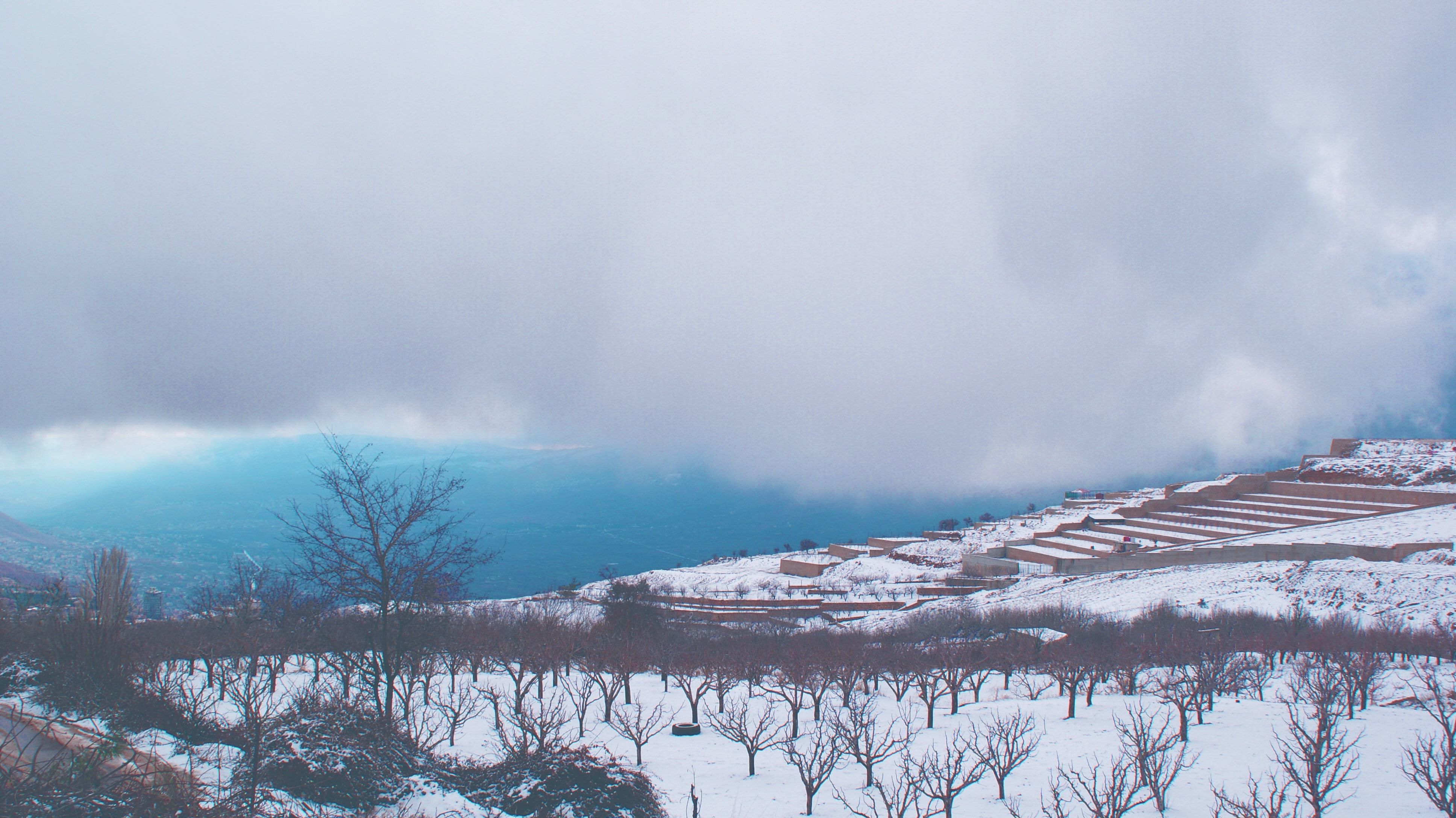 Clouds loom overhead while snow covers a terrace in Bloudan, Syria