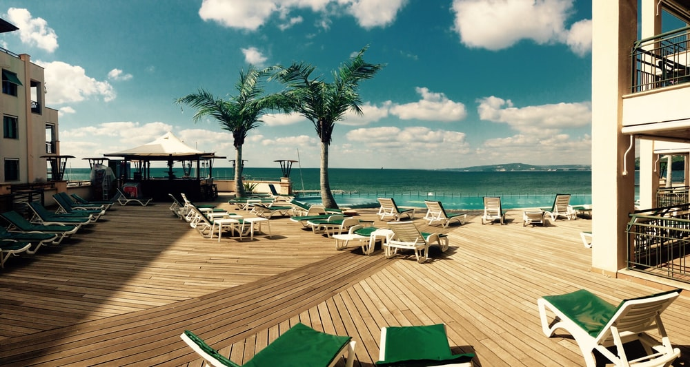 green loungers on dock at daytime