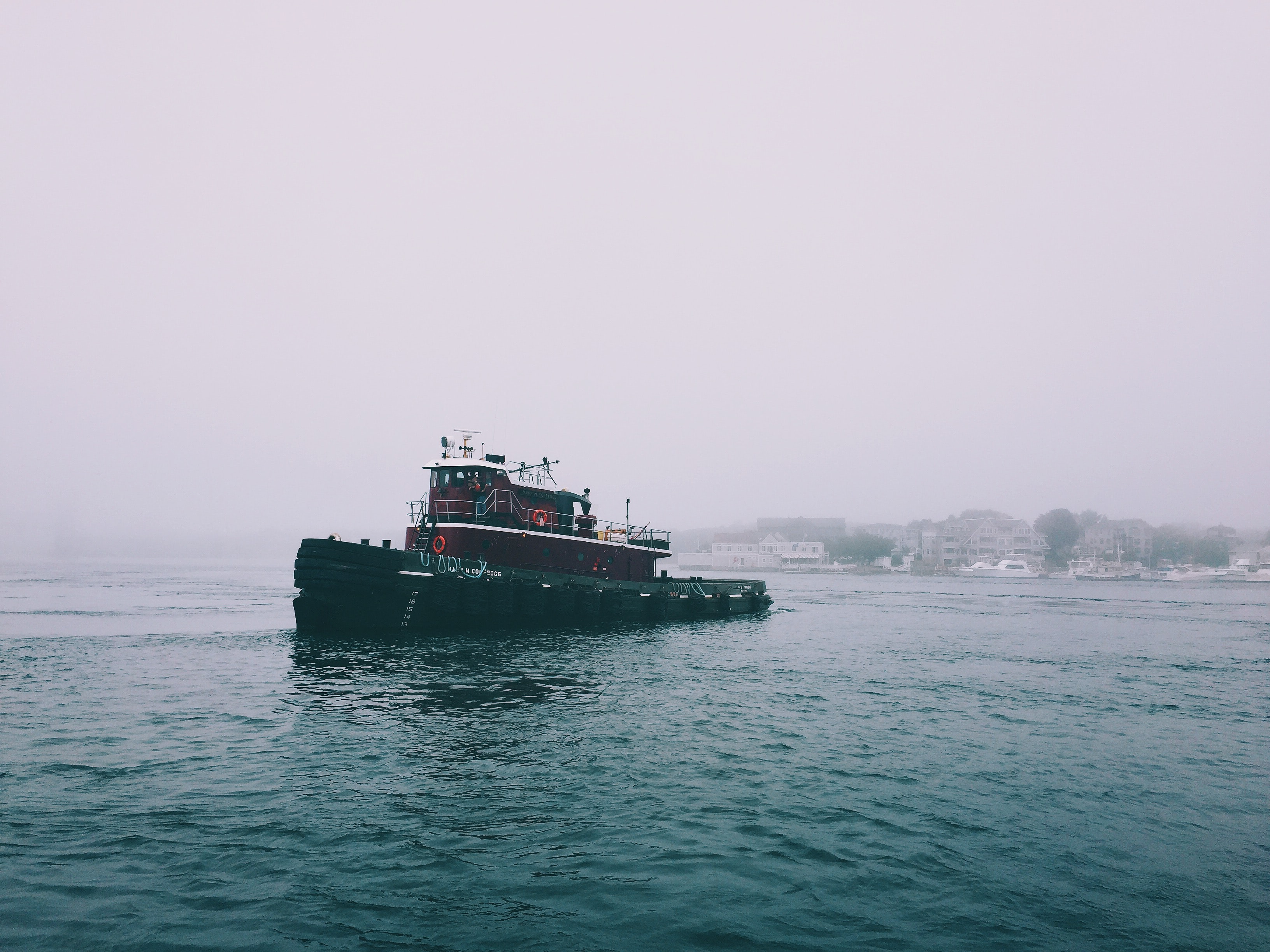Ferry boat crosses a foggy bay off the coast of New Hampshire