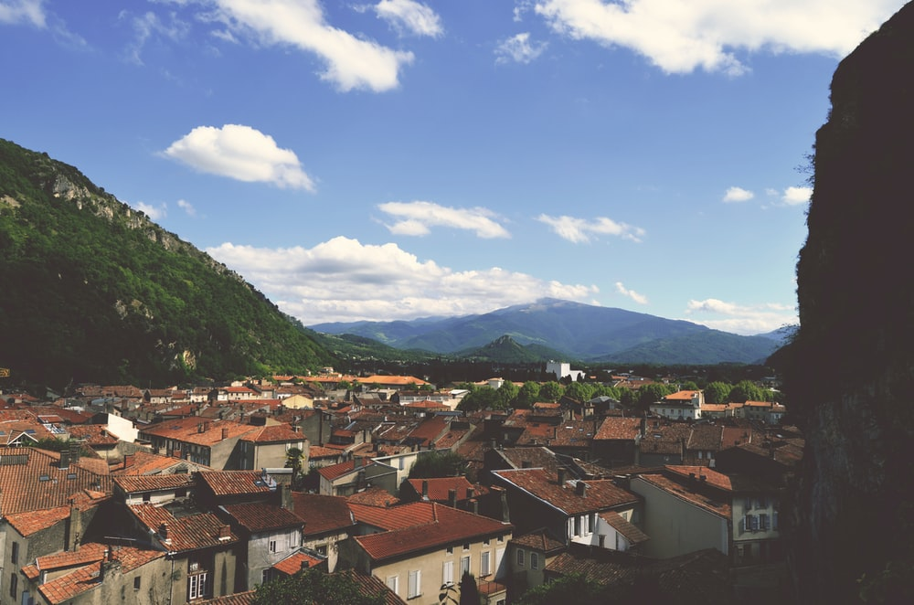panoramic photography of village between mountains