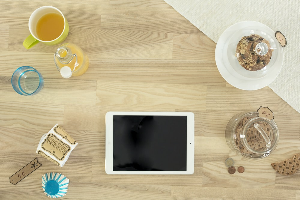 white iPad on table