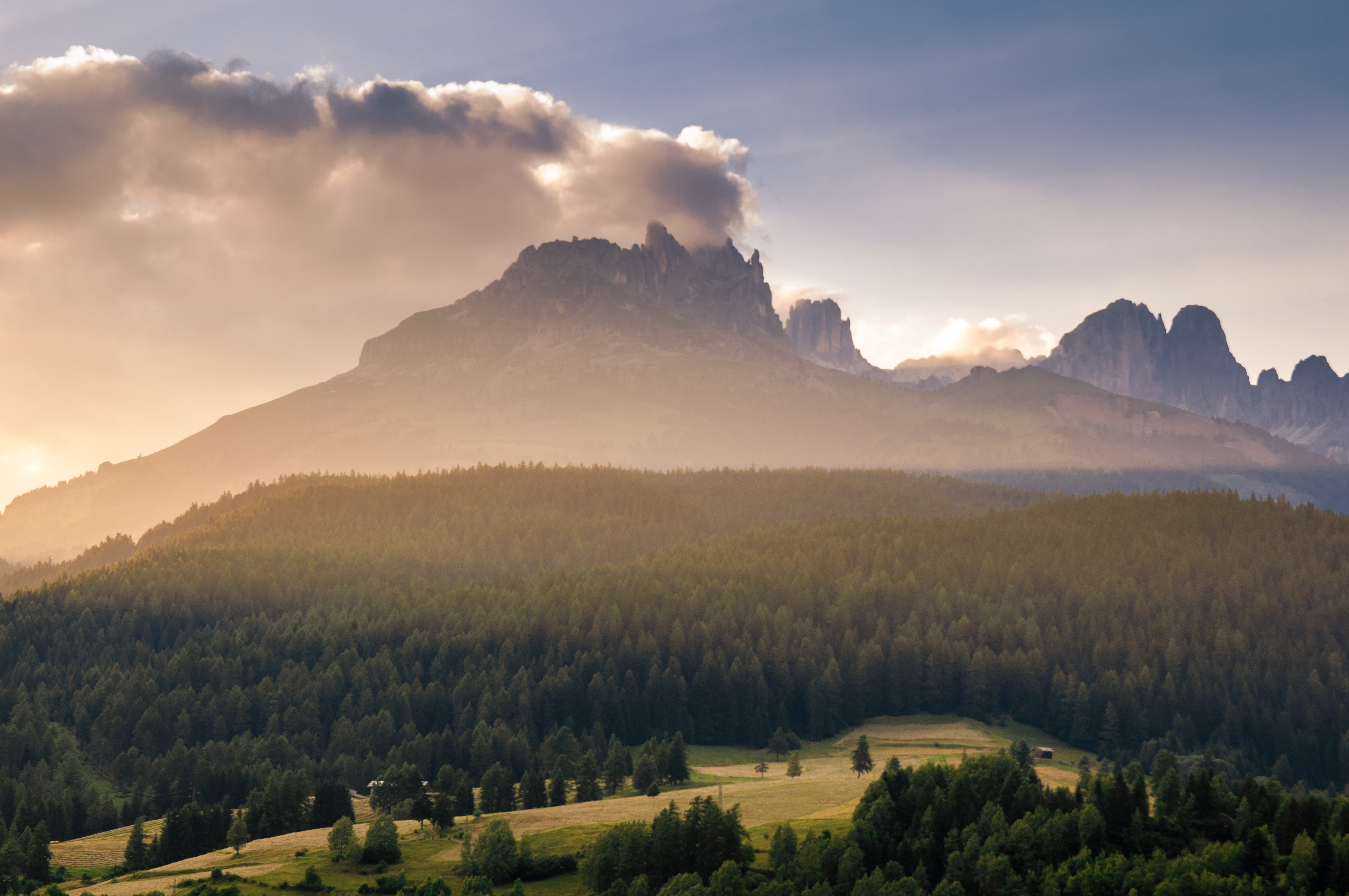 The trees, the mountains, and the clouds in the Dolomites