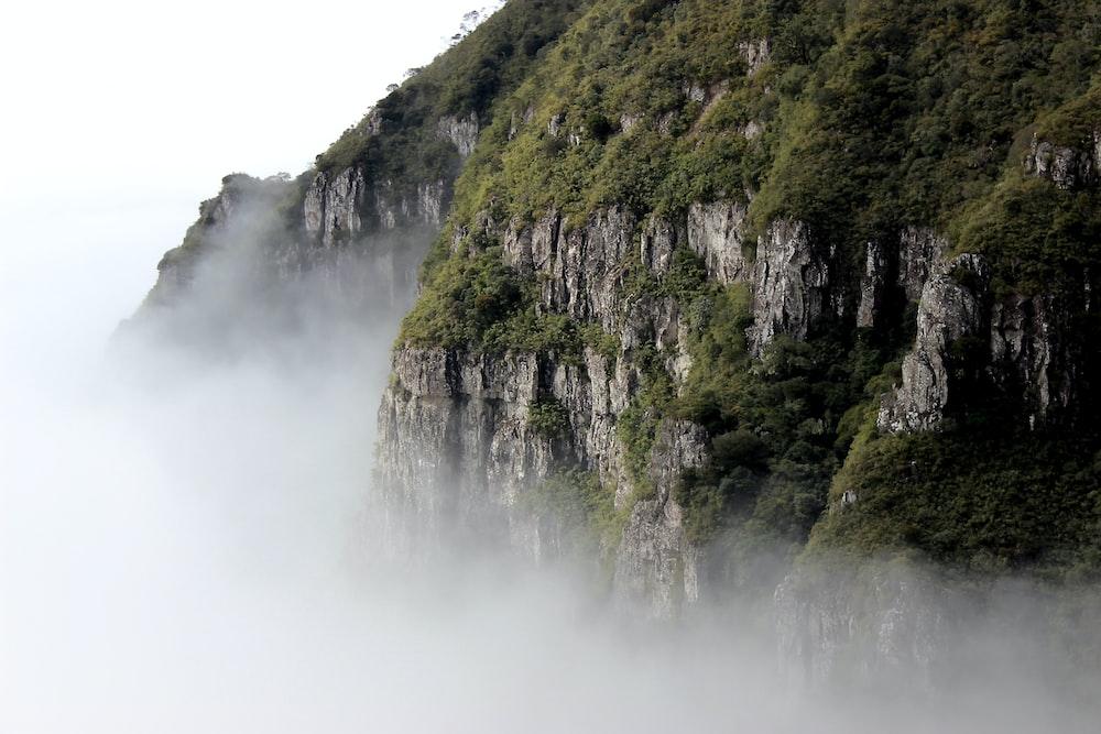 green mountain near cloudy sky
