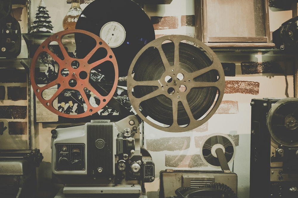 Old video tapes and vinyl records on the wall