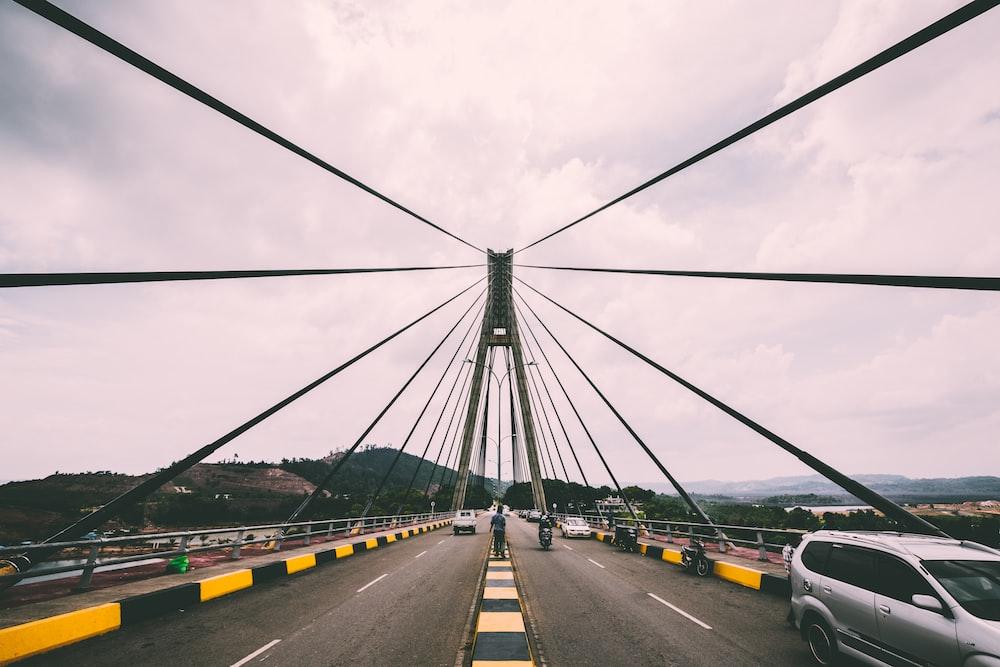 cars on concrete bridge during daytime