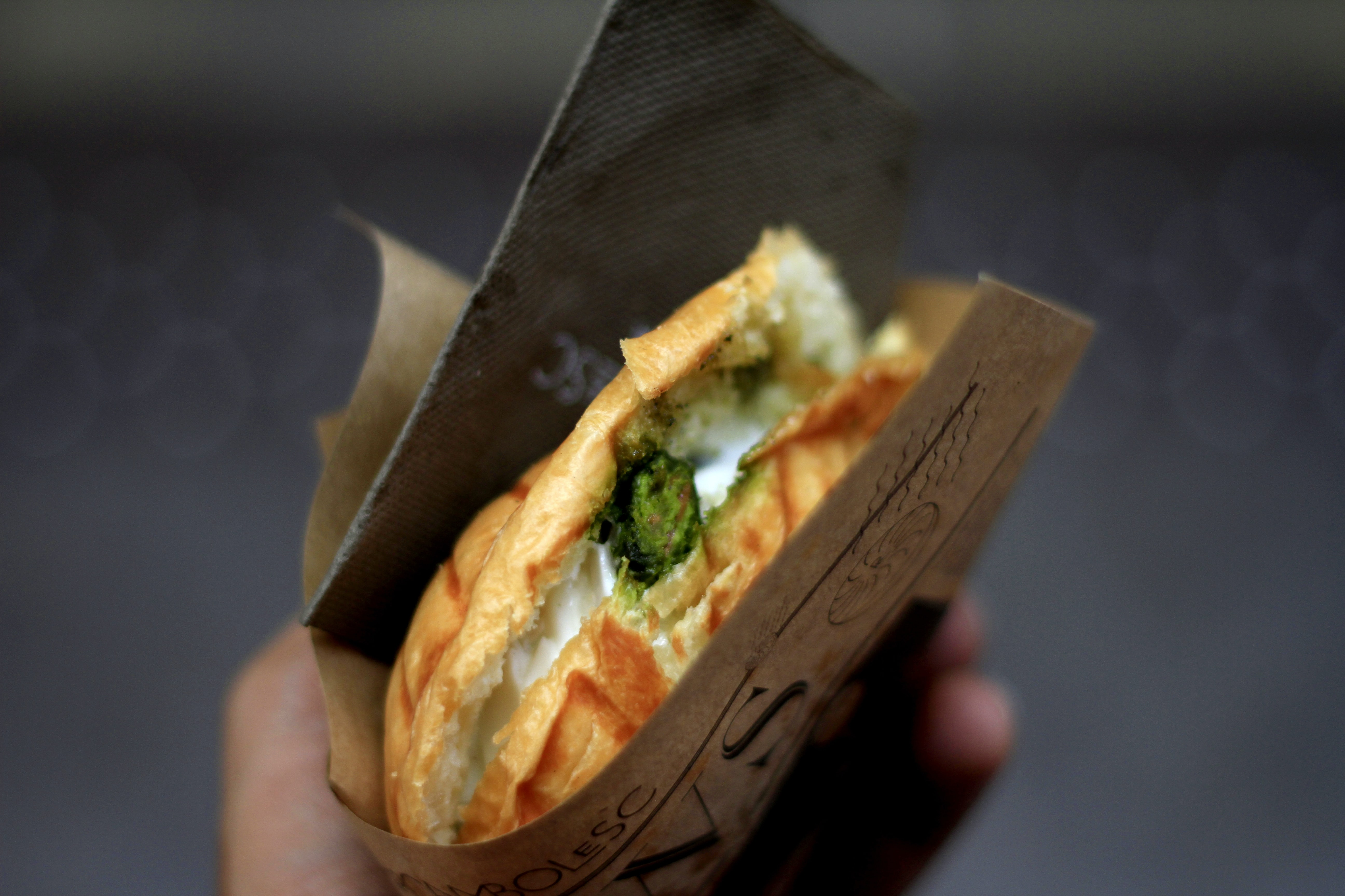 Panini sandwich with cheese and vegetables from a street vendor