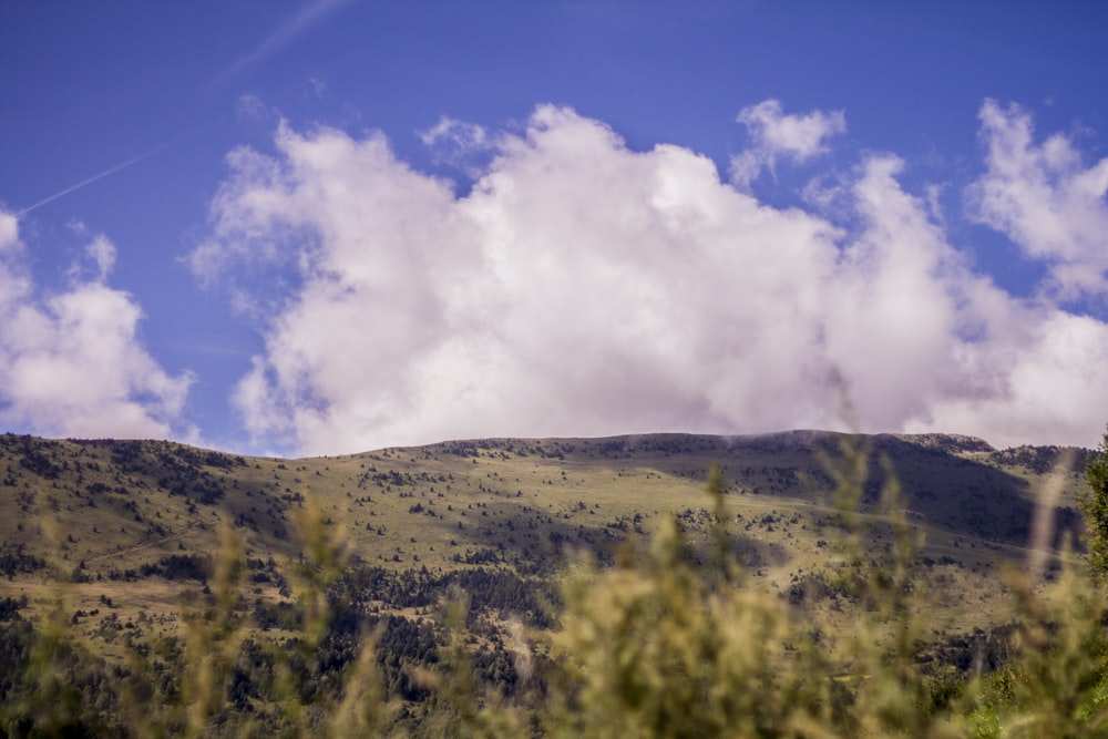 mountain near clouds