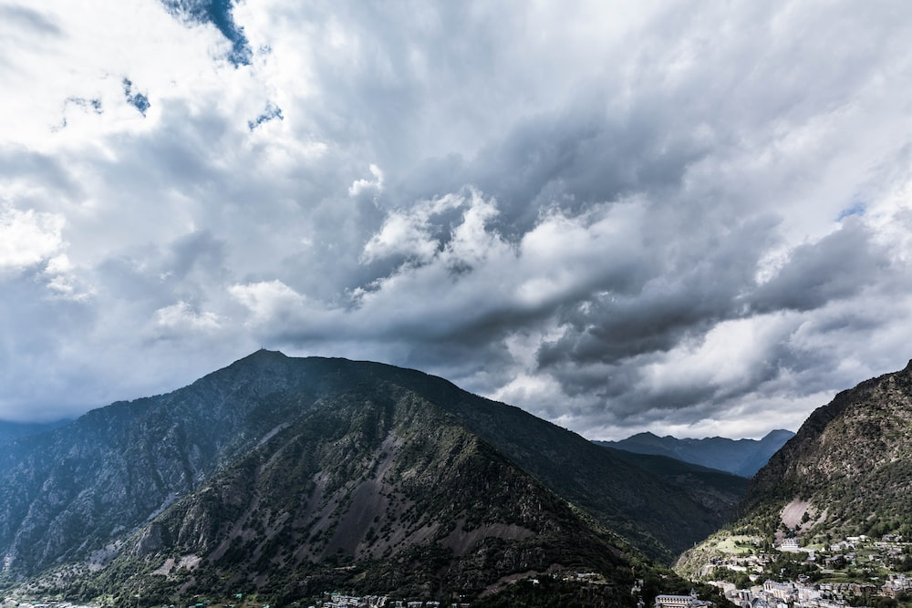 time lapse photography of clouds over mountain