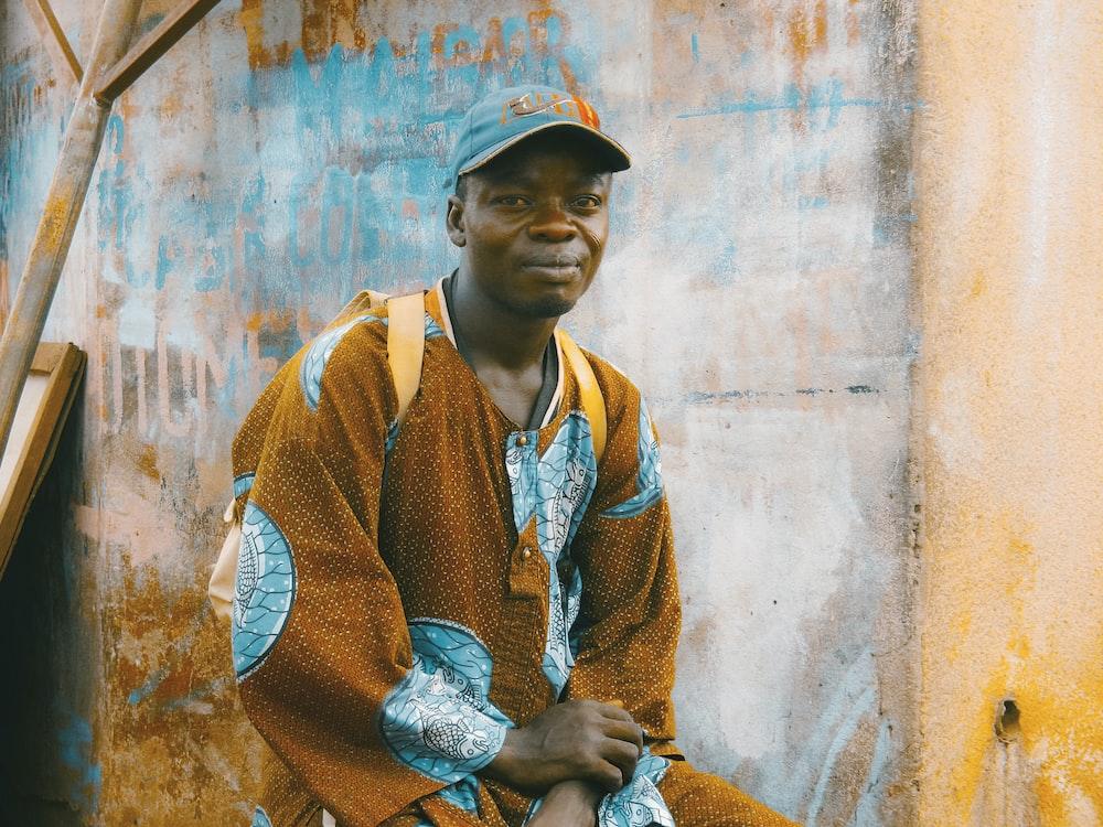 man sitting on chair near wall