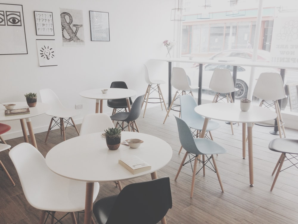 minimalist photography of white table and chairs resto