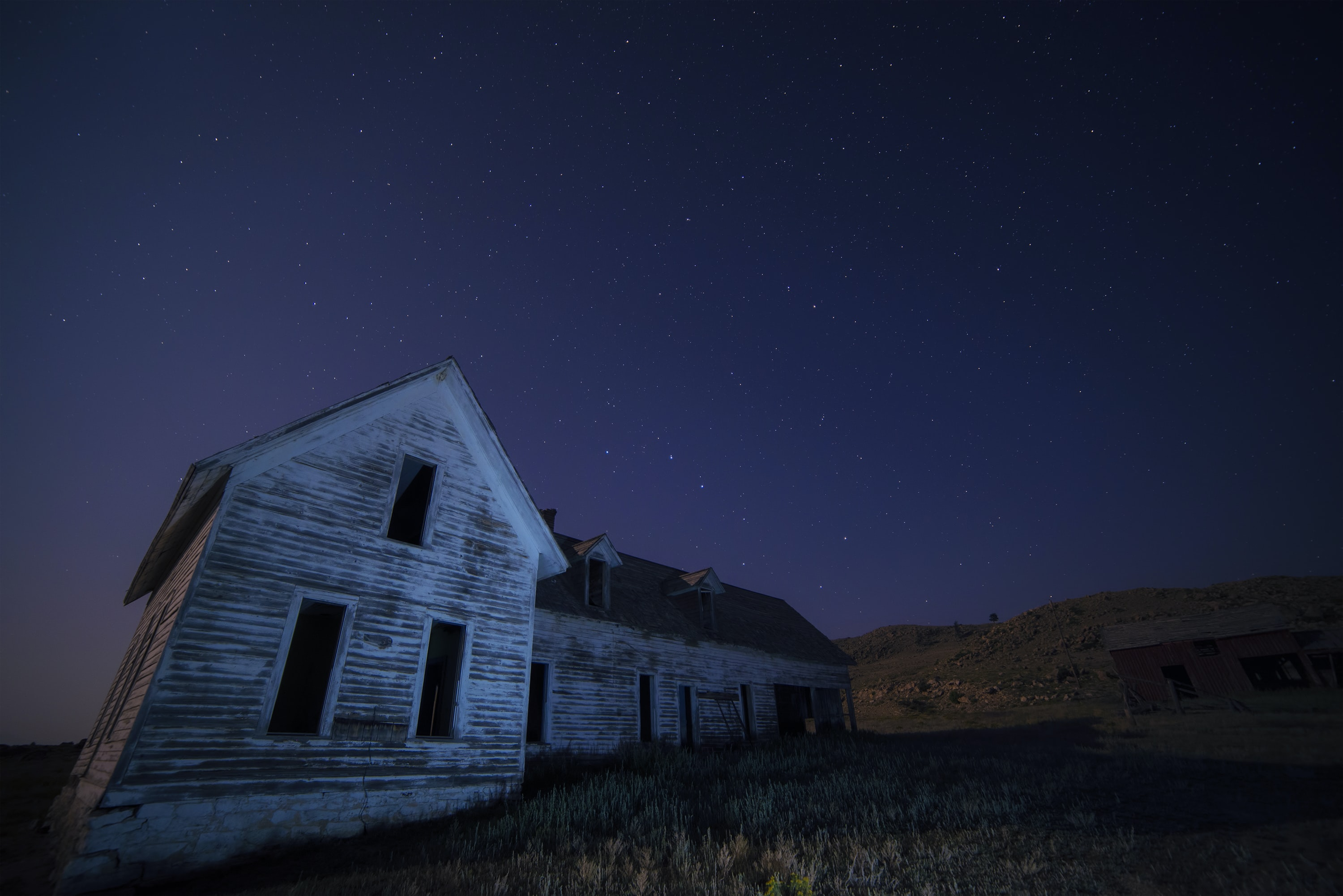 house on field under sky with stars