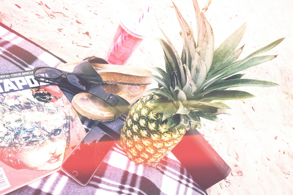 pineapple beside phone and speaker