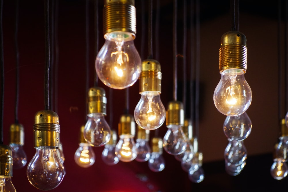 Light bulbs hanging in a red room in Castiglione del Lago