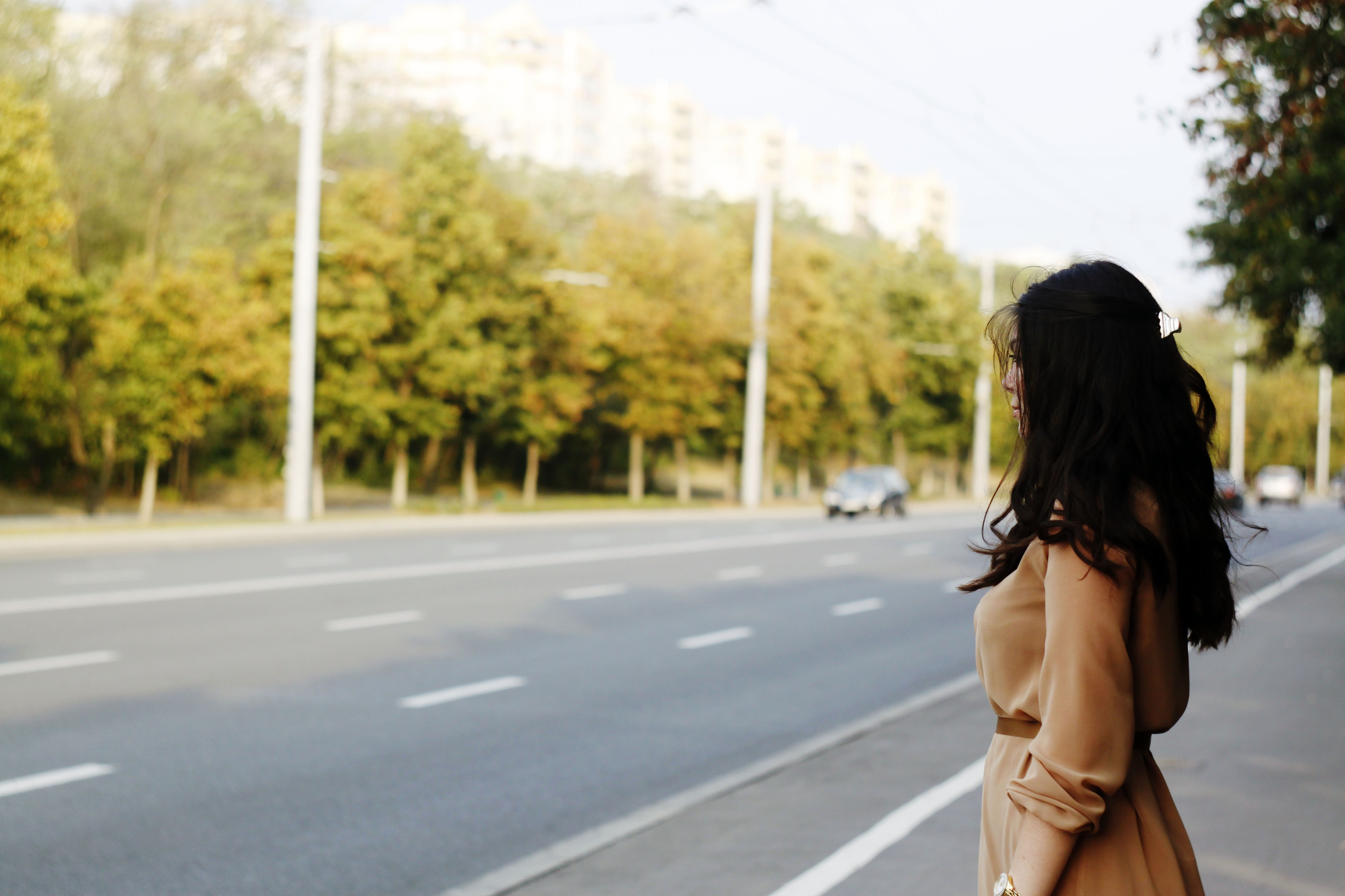 woman standing beside road
