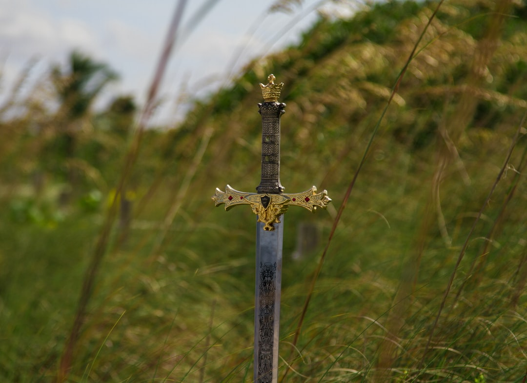 Decorated sword in grass field