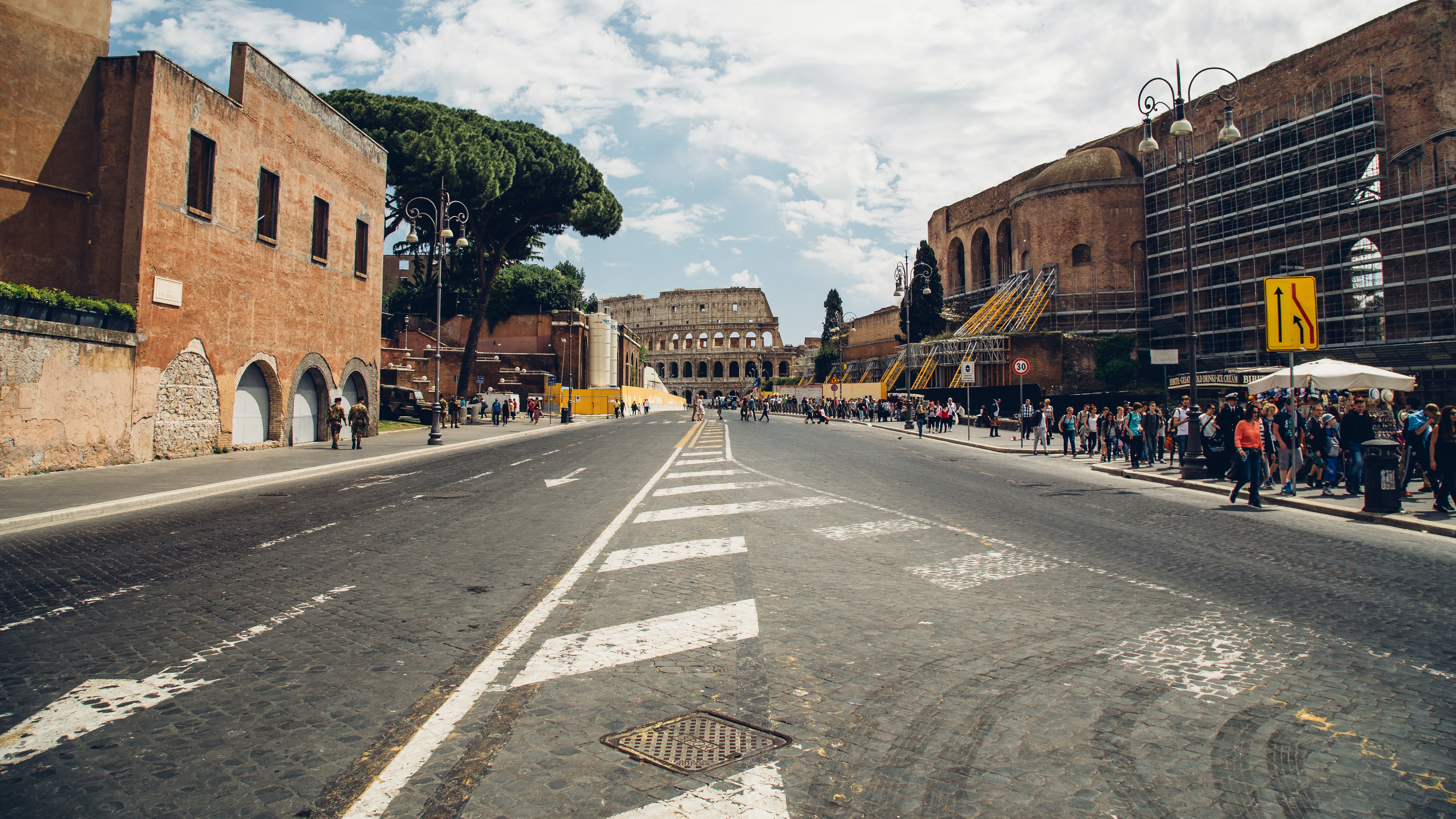 The Coliseum in Rome at the end of a street