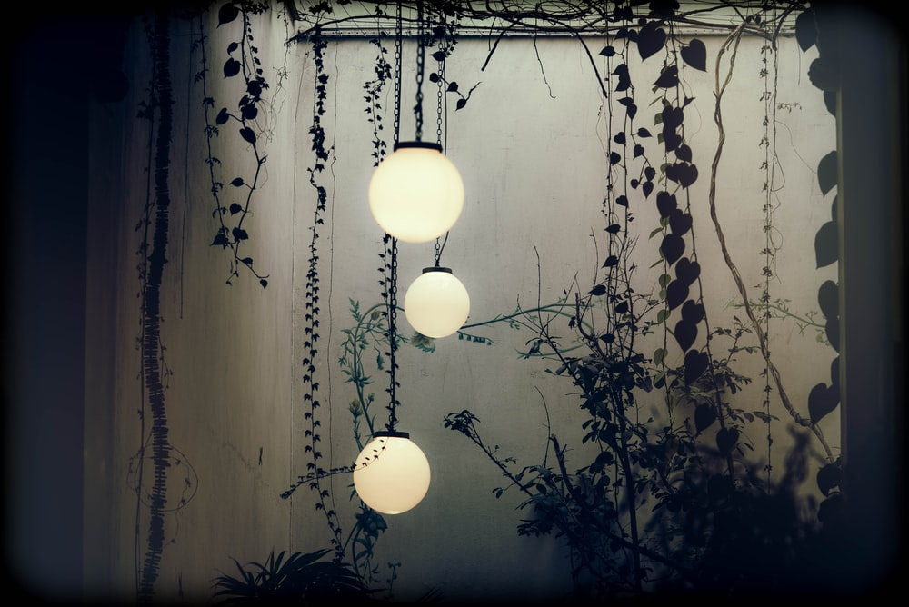 three white lighted hanging lights