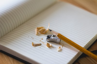 pencil and sharpener on notebook page