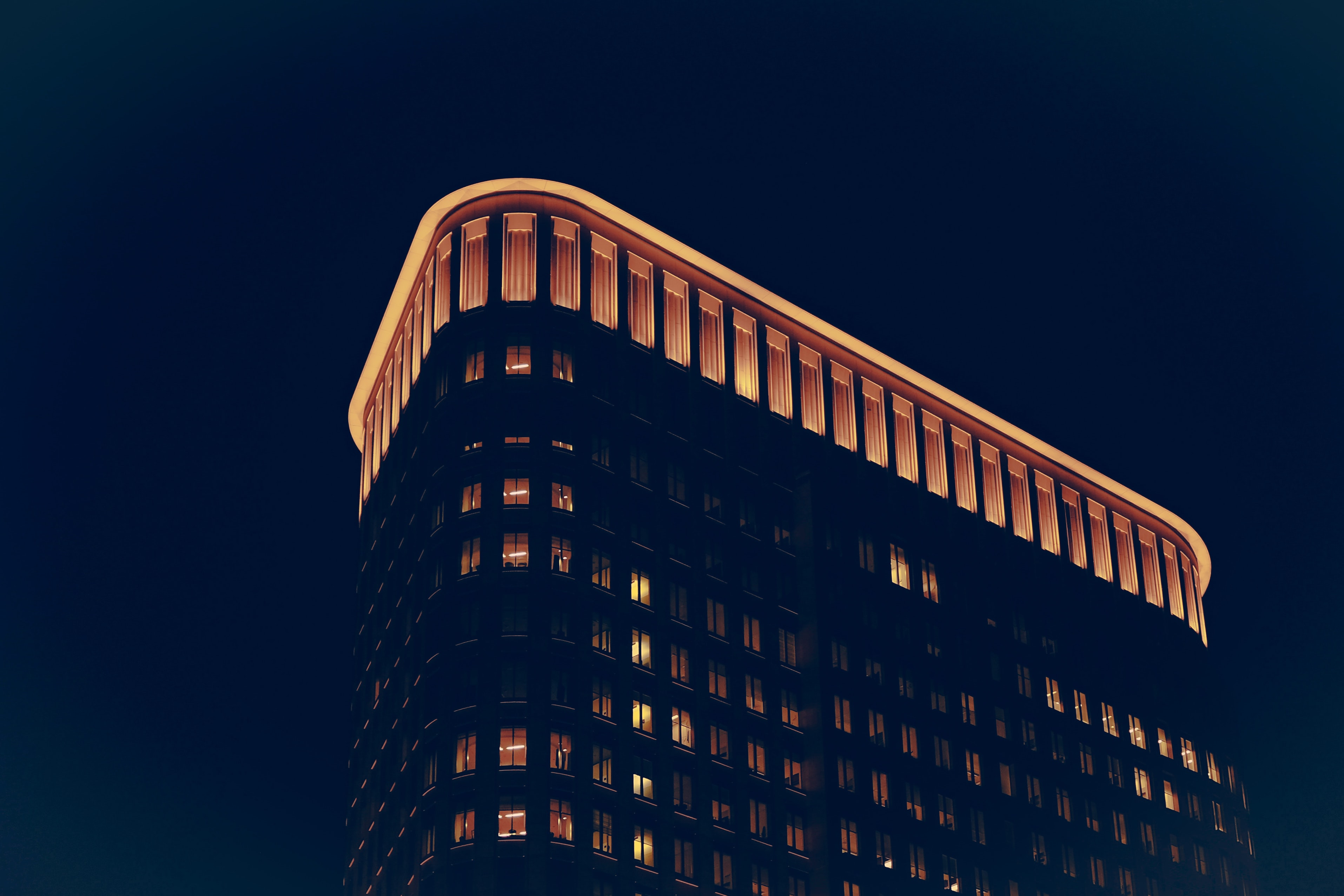 low angle photo of building at nighttime