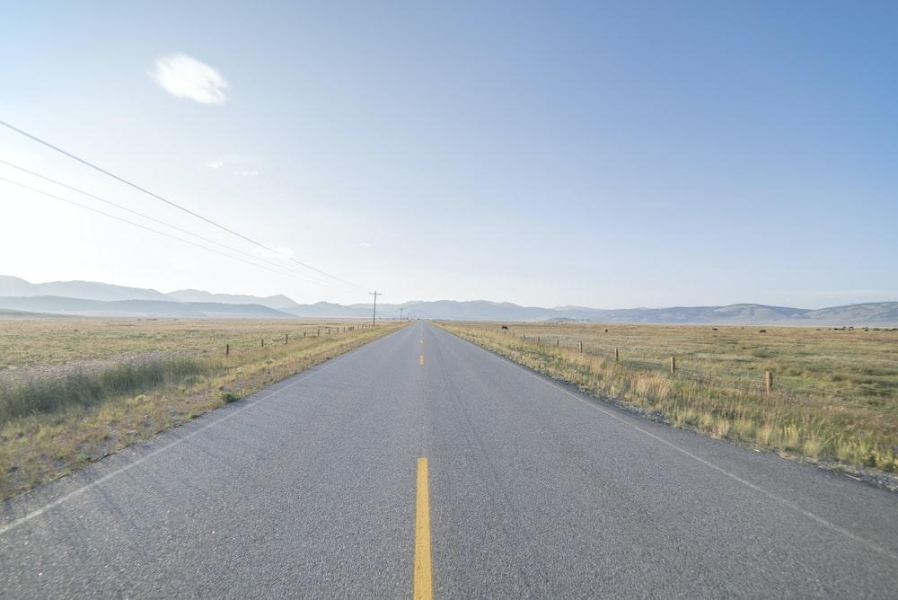 road between grass fields