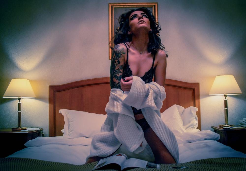 woman kneeling on white mattress