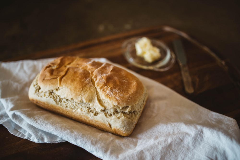 brown bread on white textile