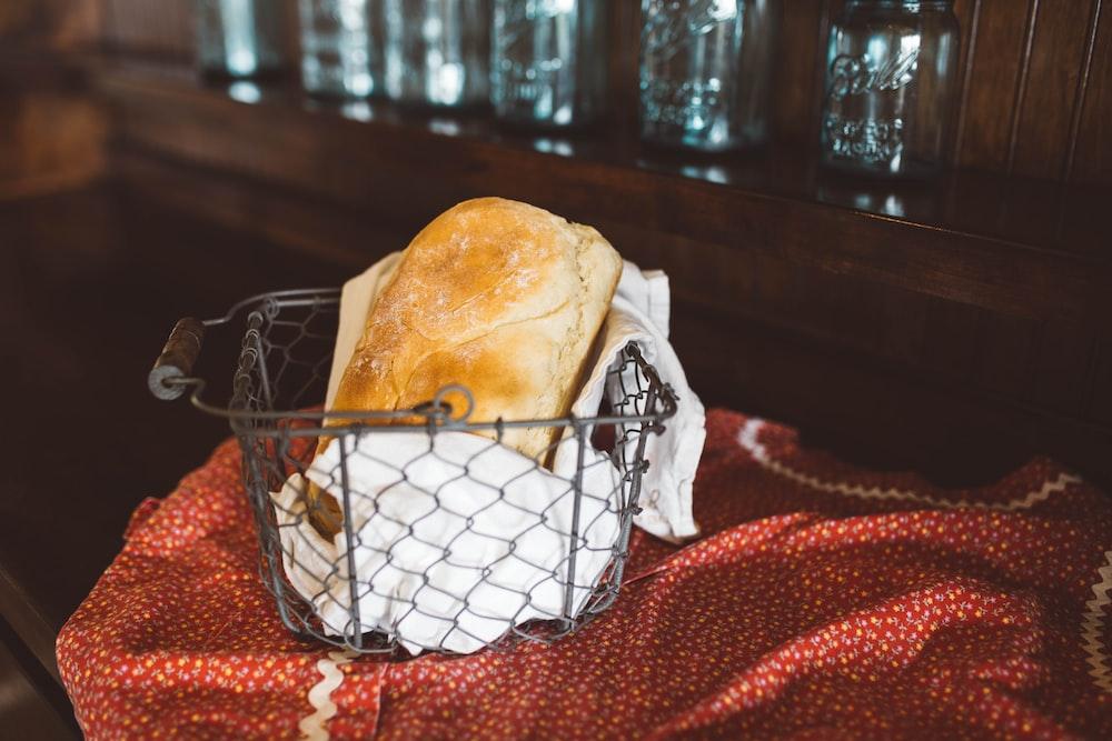brown toast bread in gray steel basket