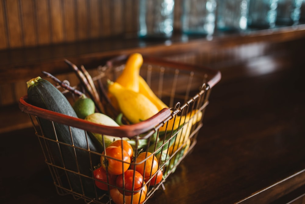 selective focus photography of vegetables in basket
