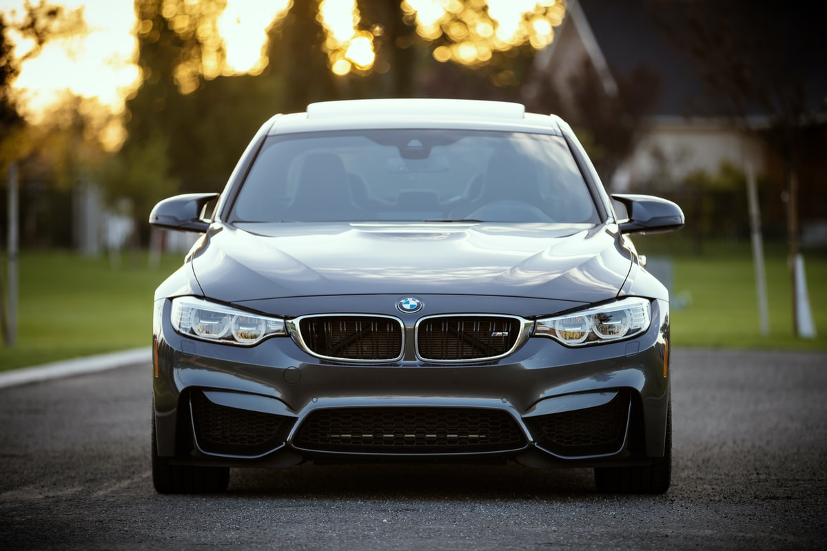Photograph of a the front of a blue BMW 3-series.