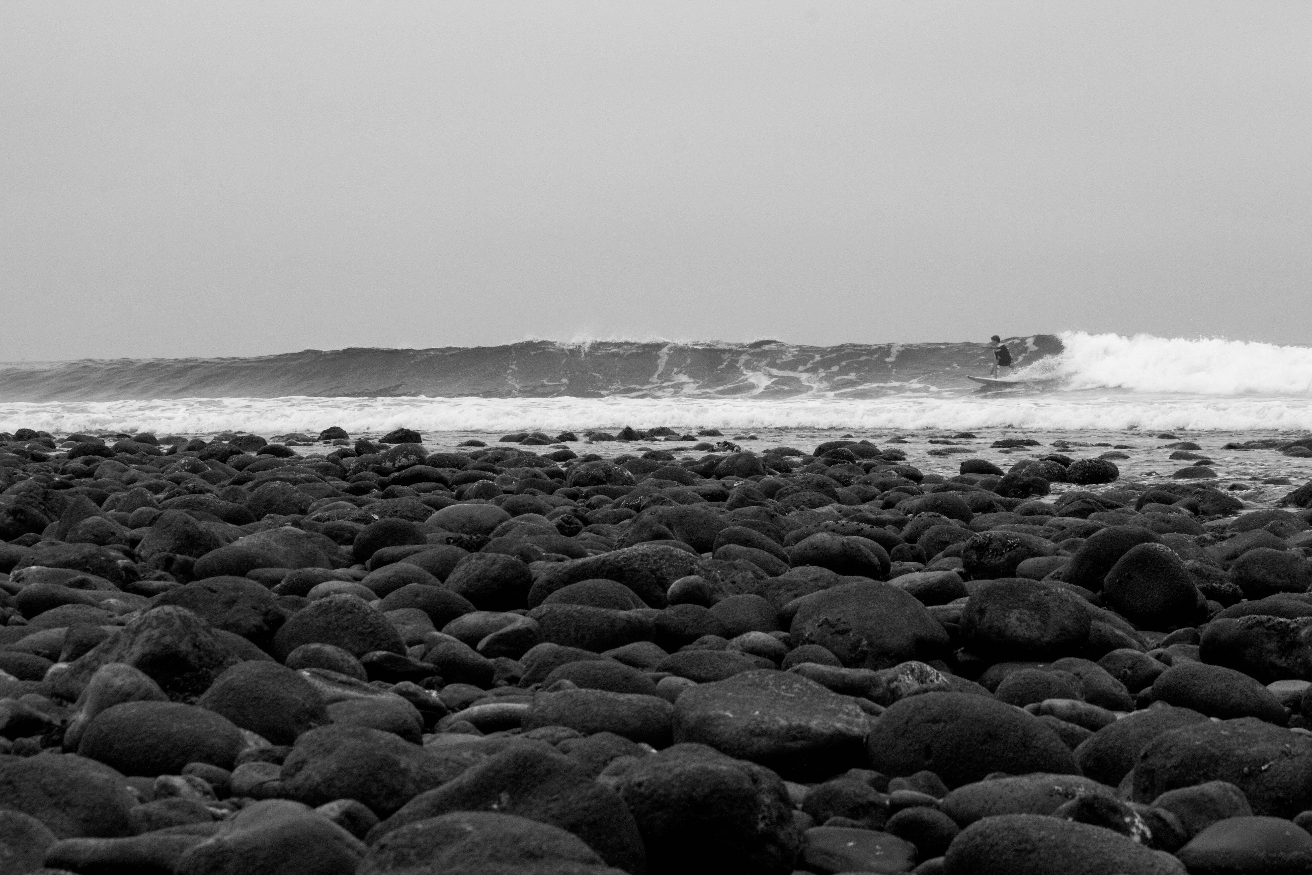 gray stones near the ocean waves