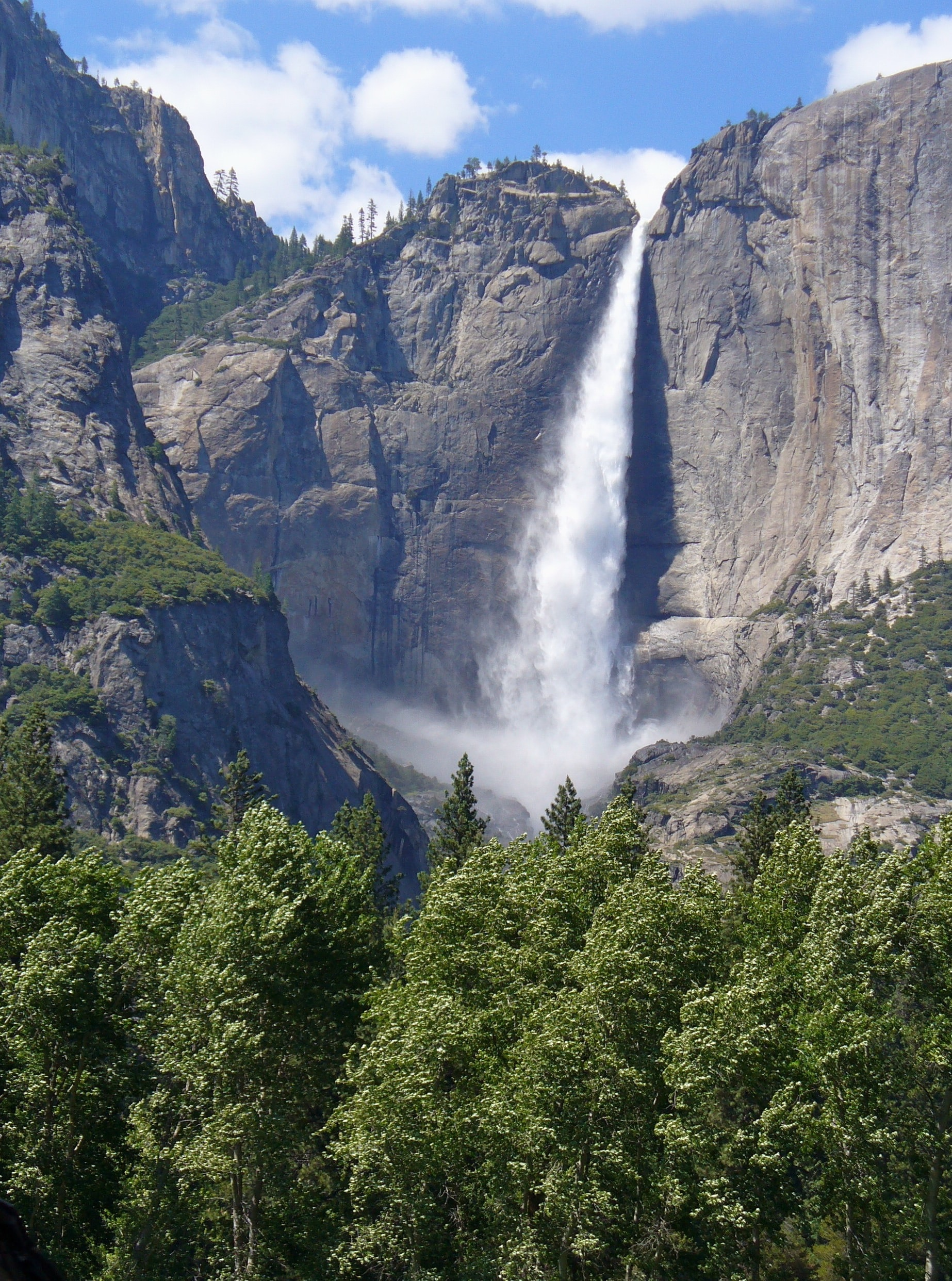 An impressive waterfall tumbling down from a vertical rock face in Yosemite