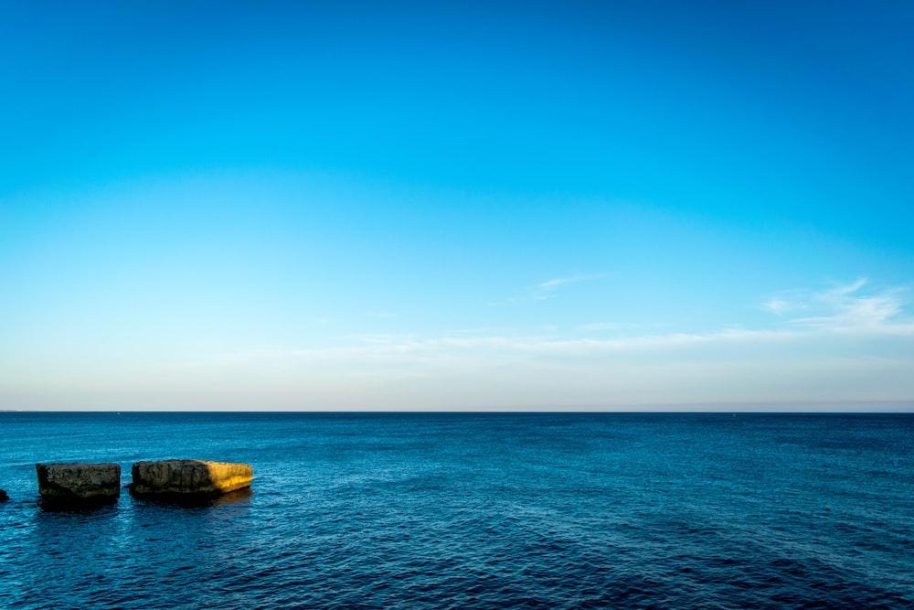 blue ocean water under blue sky