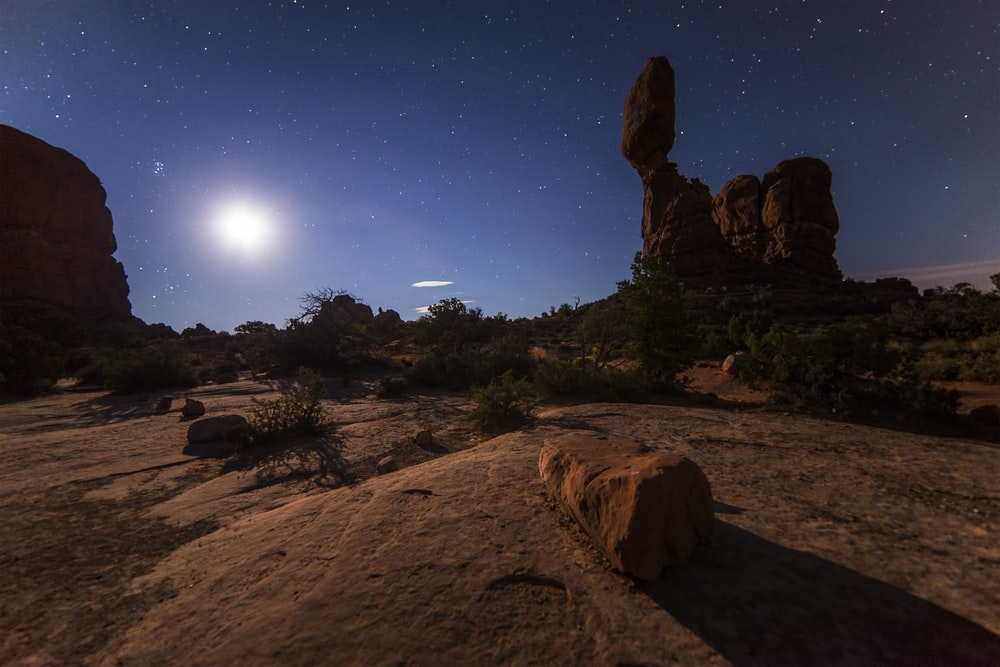 rock formation under starry skies
