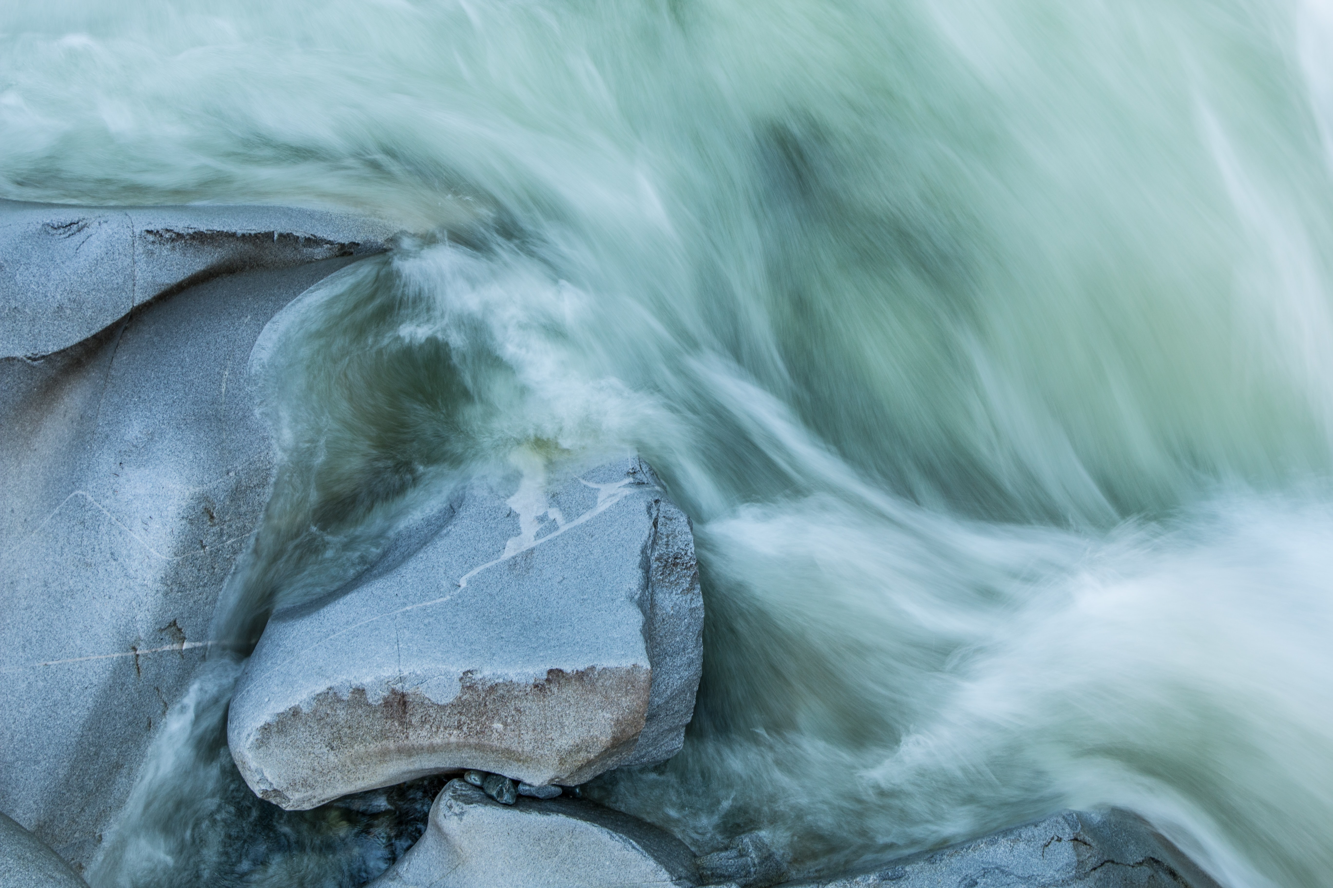 time-lapse photography of rock fragment and body of water