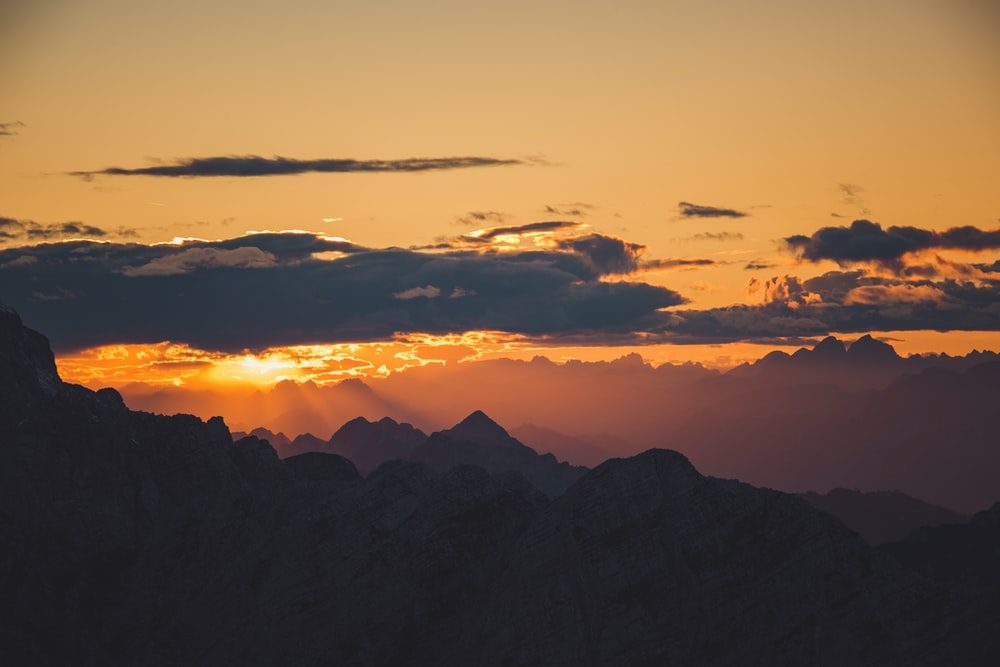 aerial photography silhouette of mountains during sunset