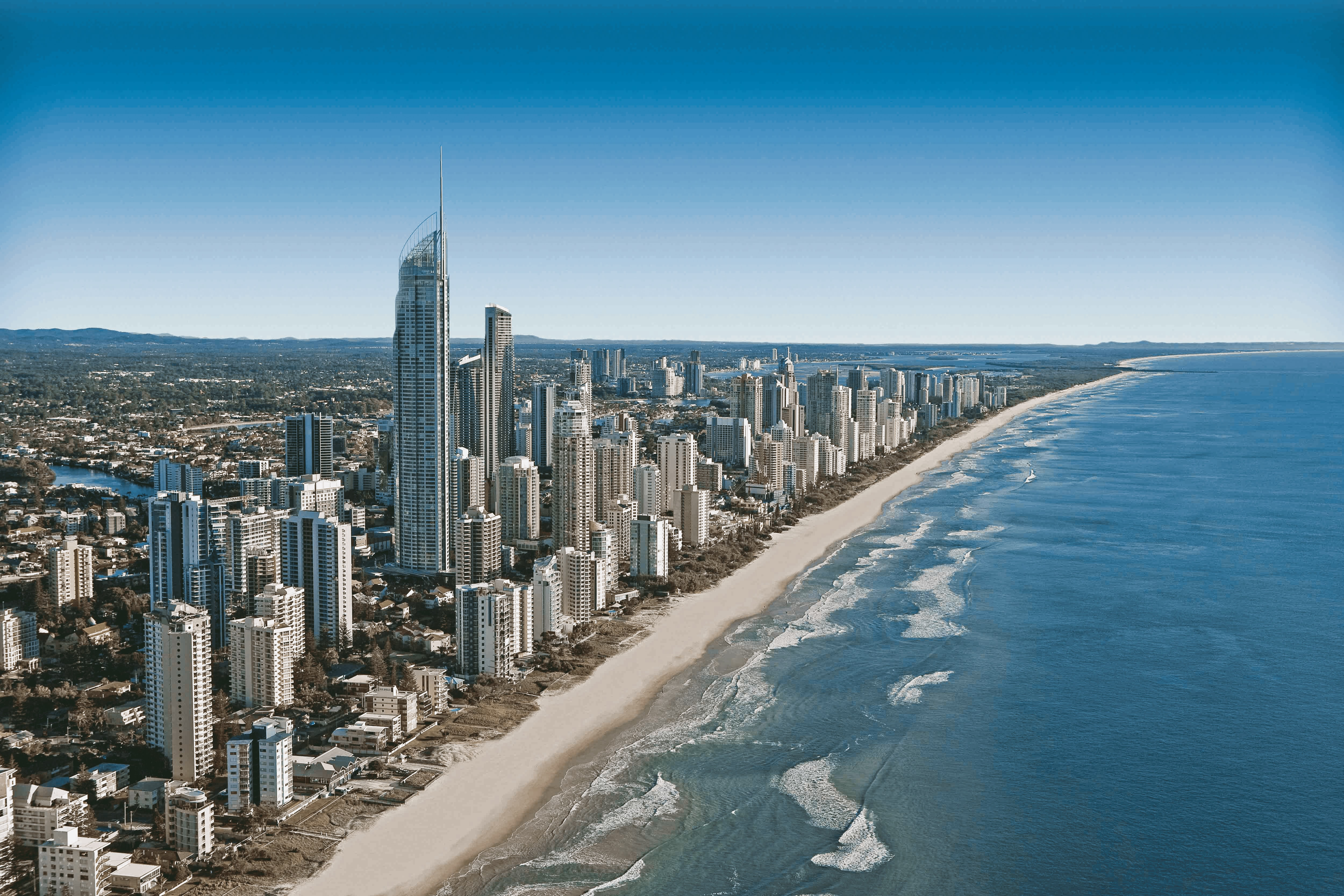 A long sandy coast with high-rises and skyscrapers