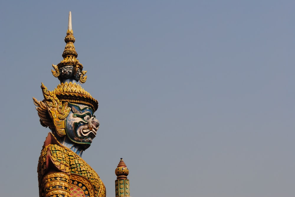 brown and blue Buddha statue