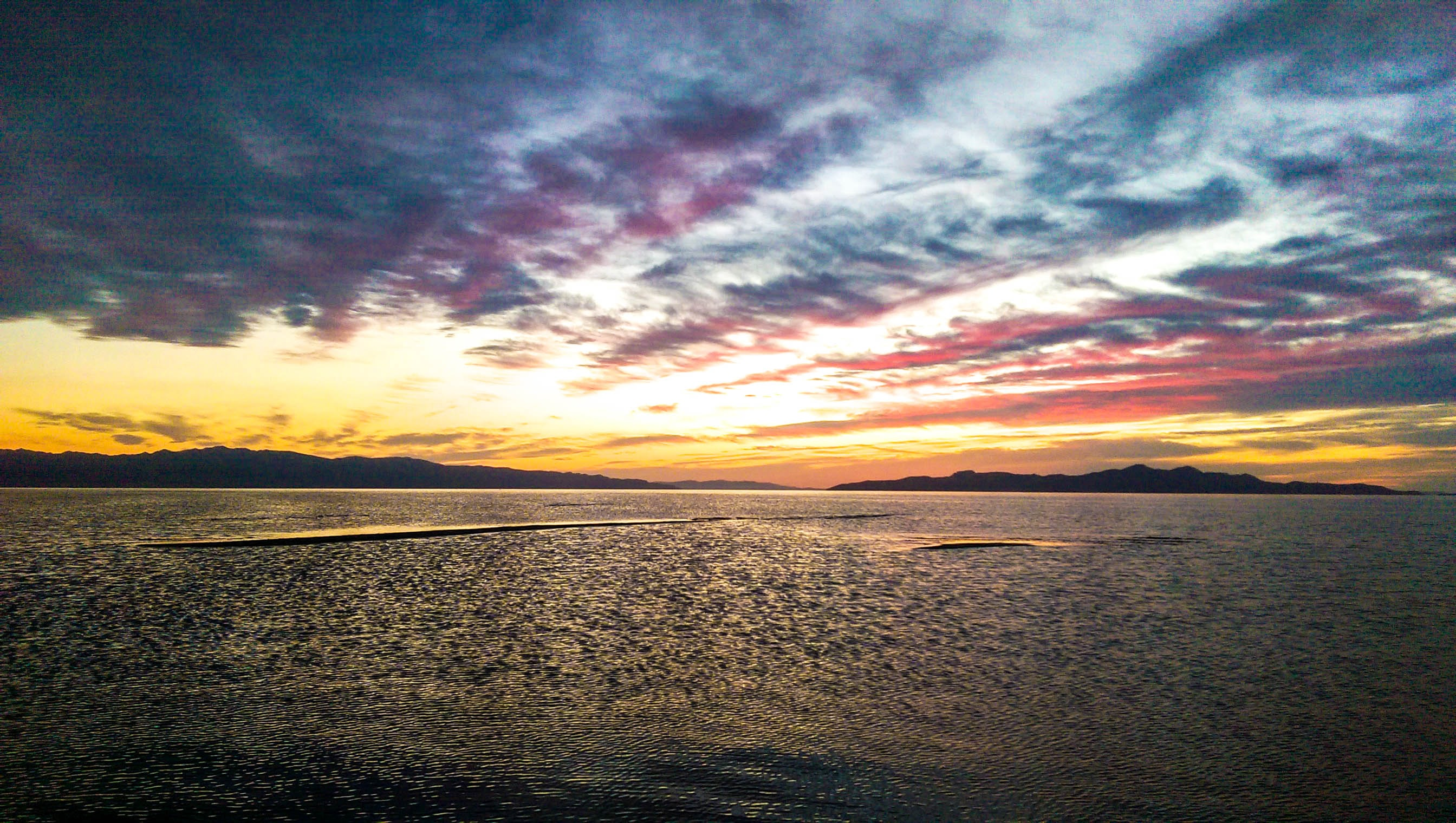 panoramic photography of body of water under golden hour