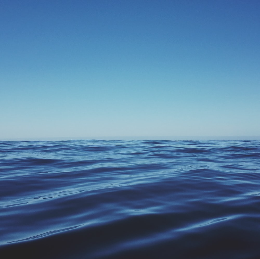 body of water under clear blue sky