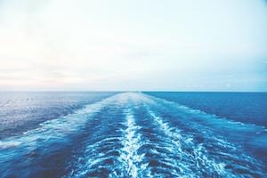 blue ocean water under white sky