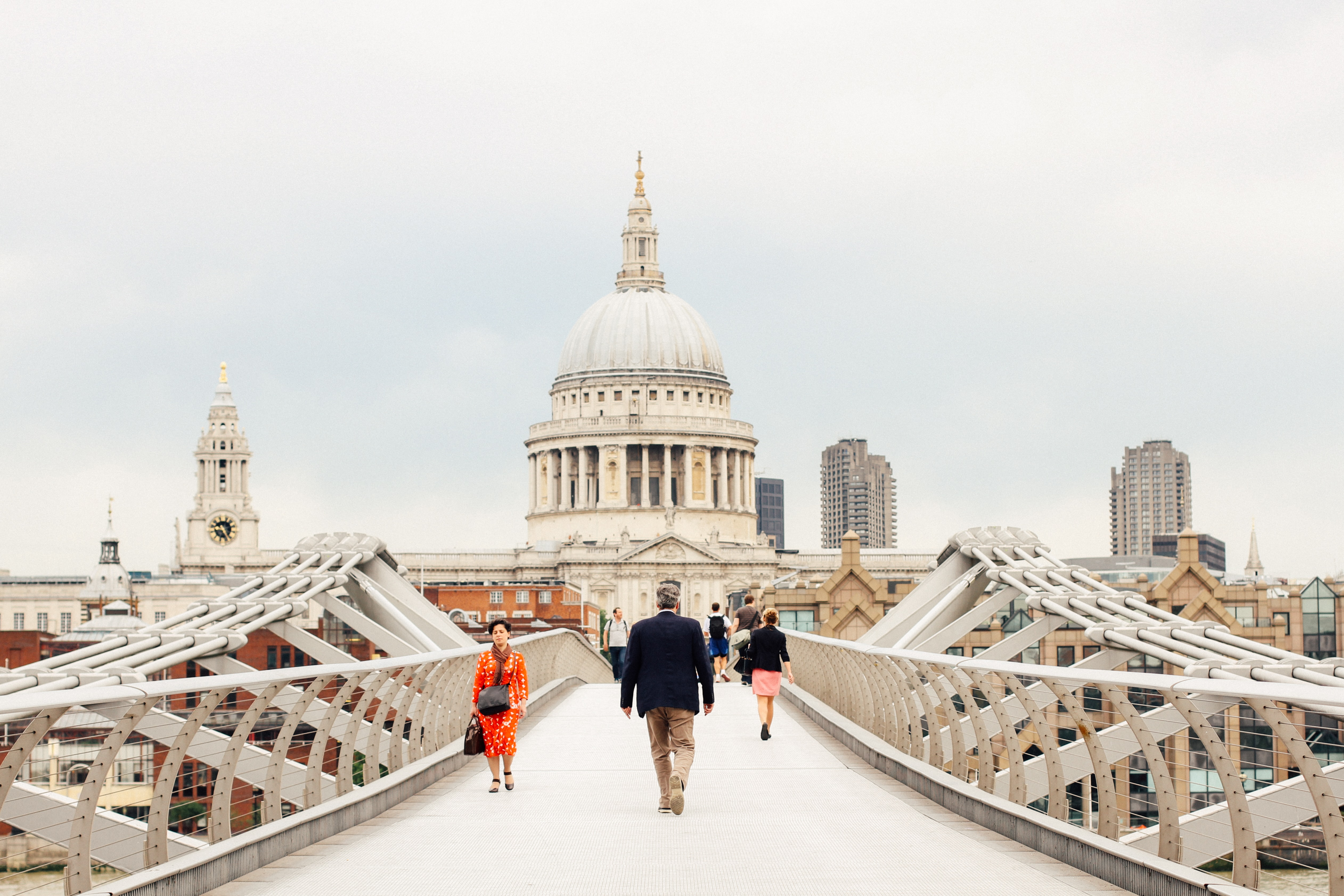 People walking over Millennium Bridge towards St. Paul's Church in London