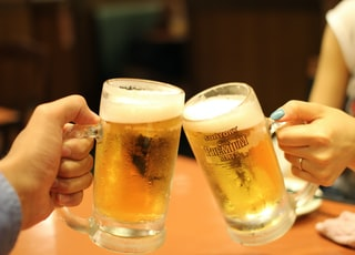 two mugs of brown liquids