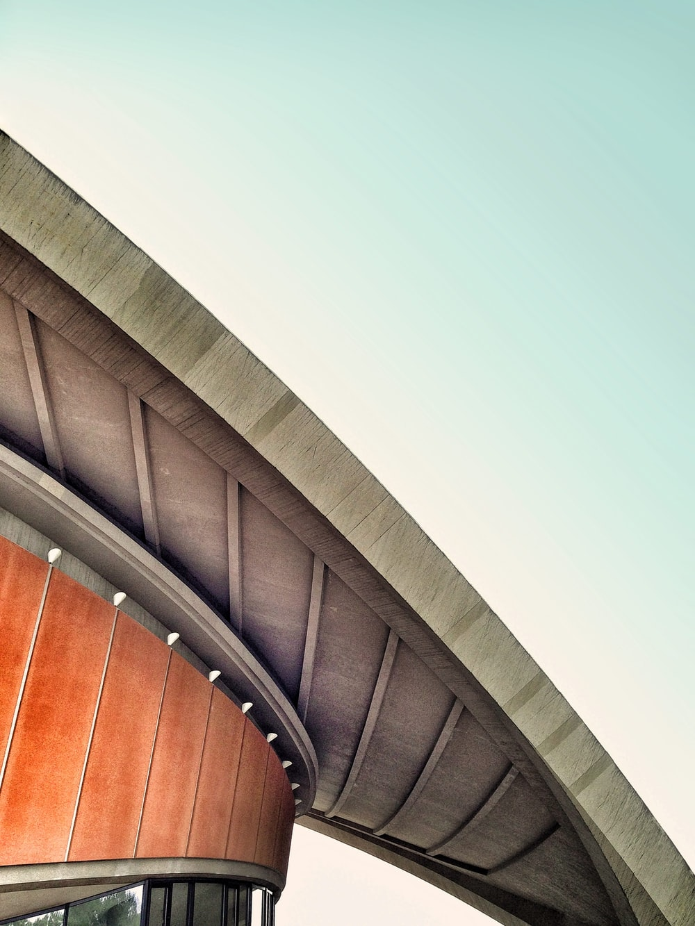 A concrete overhang in the roof of a round building