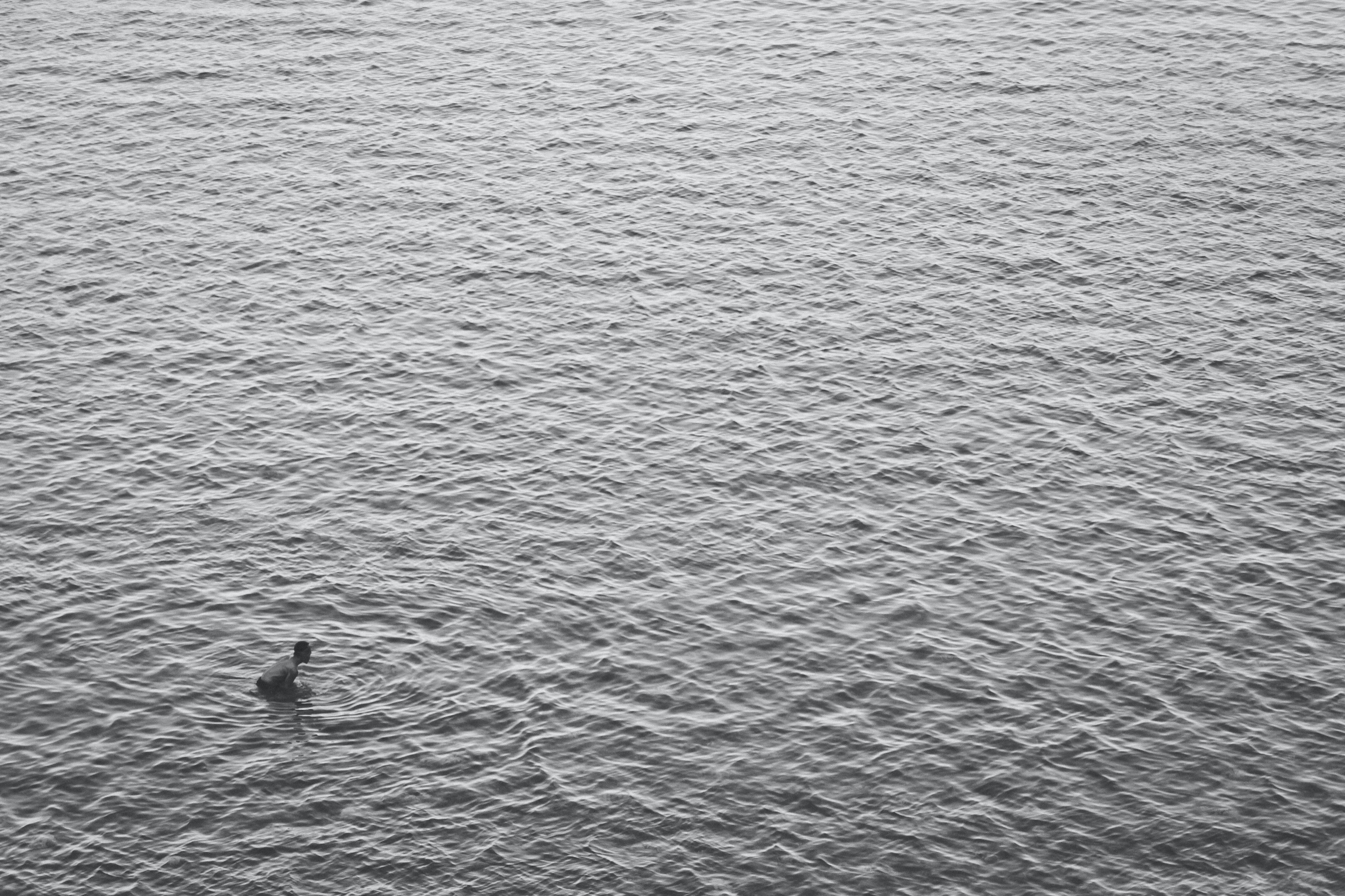 aerial view photography of person in ocean during daytime