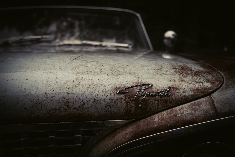 A Front View Macro Shot Of Rusty Vintage Plymouth Car