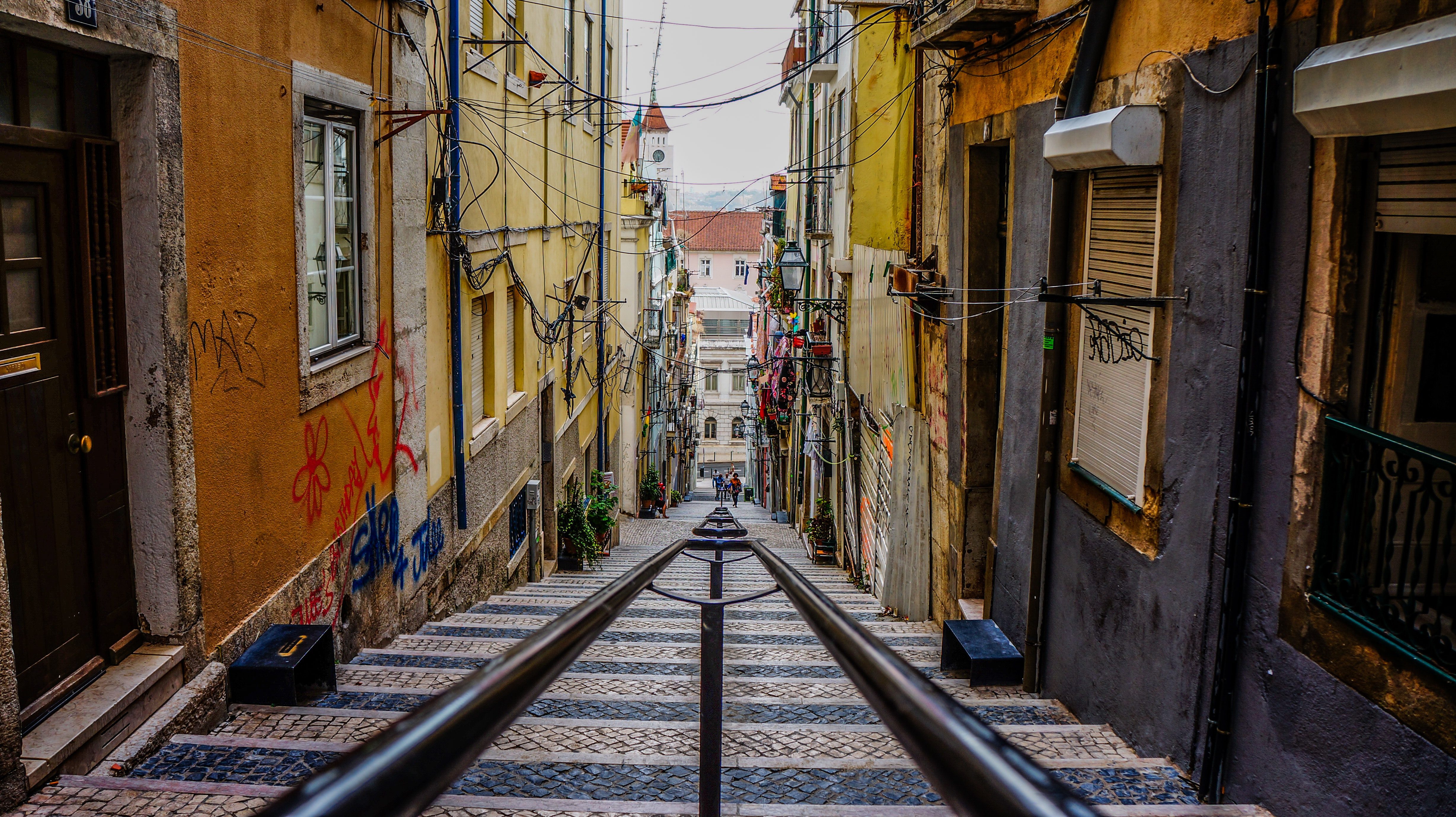 A staircase leading down an alley in Lisbon