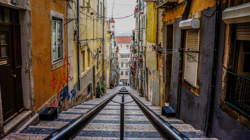 stairs in between colorful buildings