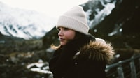 selective focus photography of woman wearing brown and black faux fur-lined coat