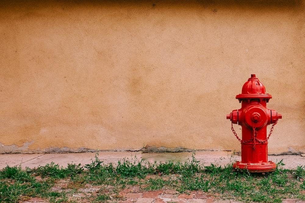 fire hydrant near beige painted wall